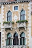 Vertical: Intricate art and sculptures adorn the historic buildings in Venice, Italy. Focus on details of Venetian artistry on display throughout the city Stock Photography