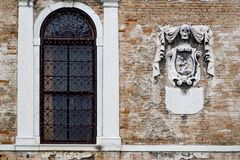 Intricate art and sculptures adorn the historic buildings in Venice, Italy. Focus on details of Venetian artistry on display throughout the city streets and Royalty Free Stock Image