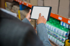 Focus on digital tablet. In a warehouse stock photos