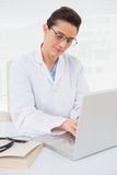 Focus doctor using laptop Royalty Free Stock Images