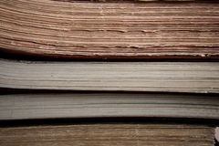 Focus on the edges of old books and registers. Picture of a closeup on the edge of some old book, registers, and other reading material Stock Images