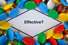 Focus on effectiveness. Colorful drawing pin is surrounding important question which have clear meaning, about effectiveness Royalty Free Stock Photos