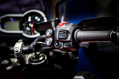 Focus of electric switch on control handle of bike Stock Images