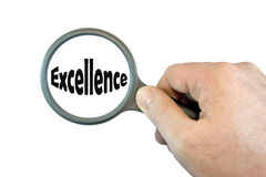 Focus on Excellence. Hand Held Magnifying Glass over the word Excellence stock photo