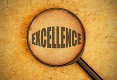 Focus on excellence. Magnifying glass focused on the word excellence stock photos