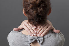 Focus on female hands making a massage on tensed body areas Royalty Free Stock Photo