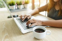 Focus finger typing on laptop computer Royalty Free Stock Photo