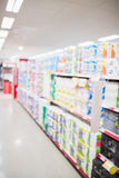 Focus on foreground of an aisle. On a grocery royalty free stock photo