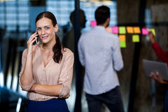 Focus on foreground of businesswoman calling Royalty Free Stock Images
