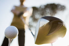 Focus on foreground of golf club and ball Royalty Free Stock Photography