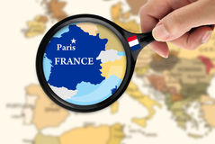 Focus in France. Magnifying glass over a map of France Royalty Free Stock Image