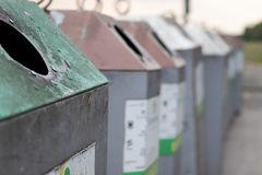 Glass recycle bins for different colored glass royalty free stock photo