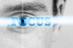 Focus. Futuristic image of sign Focus using human eye as the letter O Royalty Free Stock Photos