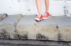Focus on girl in red shoe Royalty Free Stock Photography