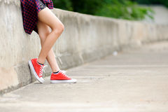 Focus on girl in red shoe Royalty Free Stock Image