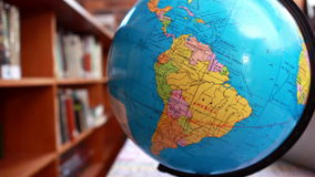 Focus on globe in the library. In elementary school stock video footage