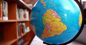 Focus on globe in the library. In elementary school stock footage