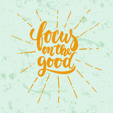 Focus on the good- hand drawn lettering phrase isolated on the green grunge background. Fun brush ink inscription for Stock Image