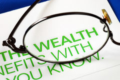 Focus on growth in wealth. Isolated on blue Royalty Free Stock Images