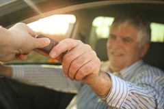 Senior man holding a car key. Royalty Free Stock Photography