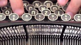 Focus on hand typing at old typewriter. Detail of hand typing at old retro vintage typewriter, UHD 4K stock video footage