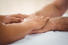 Focus on hands. In a retirement home royalty free stock image