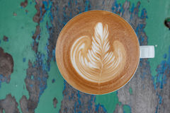 Focus hot latte of cup on wood Stock Photography