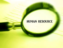 Focus on Human resource. A concept photograph of a magnifying glass focused on the words human resource.  Conceptual photo for human resources management Royalty Free Stock Images