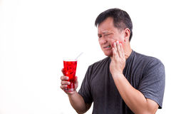 Focus on ice cold drink with man with toothache background Royalty Free Stock Photos