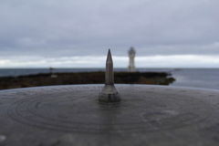 Focus. The Icelandic lighthouse behind the compass Stock Images