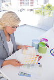 Focus interior designer looking at colour charts Royalty Free Stock Photography