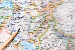 Focus on IRAN on the world map with pencil pointing Stock Images