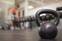 Focus on large black kettlebell in weights room Stock Photos