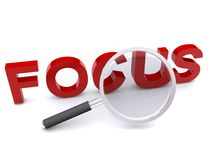 Focus and magnifying glass Royalty Free Stock Images