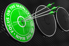 Focus on the Main Slogan - Green Target. Focus on the Main Slogan. Three Arrows Hitting the Center of Green Target on Black Background Royalty Free Stock Image