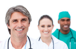 Focus on a mature doctor in front of his team Stock Image