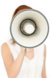 Focus on a megaphone holding by a businesswoman Stock Photo