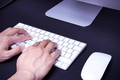 Focus on the men hand on the white keyboard and mouse Royalty Free Stock Images