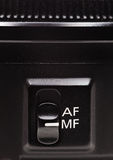 Focus mode switch on the lens Royalty Free Stock Photo