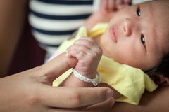 Focus on newborn baby hand Royalty Free Stock Photos