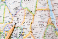 Focus on Niger on the world map with pencil pointing Royalty Free Stock Photography