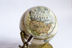 Focus on North America on a Gl. Magnifying lens enlarging and focusing on USA and Canada on a globe royalty free stock photo
