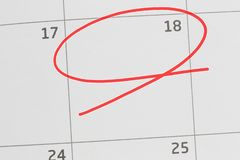 Focus on number 18 in calendar and empty red ellipse. Focus on number 18 in calendar and empty red ellipse for design in your ideas and work concept stock photo