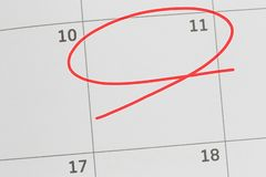 Focus on number 11 in calendar and empty red ellipse. Focus on number 11 in calendar and empty red ellipse for design in your ideas and work concept stock image