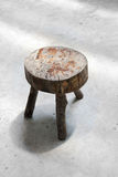 Focus old wooden stool on the cement floor Stock Photos