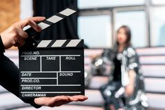 Free Focus On Clapper Board With Woman On Stage On Background. Movie Or Clip Production Backstage Royalty Free Stock Photos - 173257788