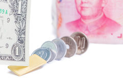 Focus on one US dollar bill with blurred Chinese yuan banknote a Royalty Free Stock Photos