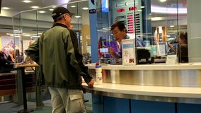 Focus of people exchanging money inside airport. stock footage