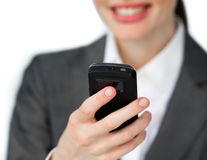 Focus on phone holding by a smiling businesswoman Stock Photos