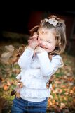 Focus Photo of Girl in White Long Sleeve Shirt With Brown Leaf on Her Head Royalty Free Stock Photos